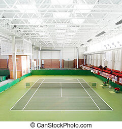 Tennis court - Empty green indoor tennis court (focus on the...
