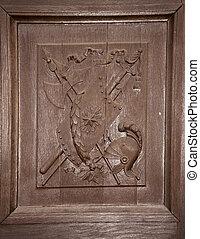 wooden carved door coat arms helmet shield swords - Brown...