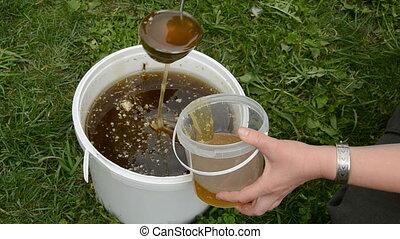 liquid honey in the bucket