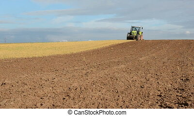 tractor in the first tillage - tractor in the first autumn...