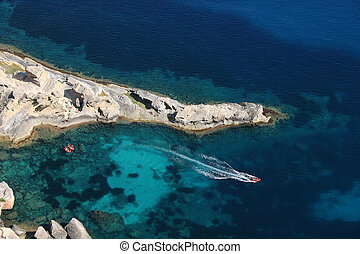 Turquoise Water in Ibiza Island - Aeriel view of three red...