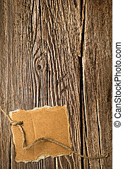 Old wooden texture and cardboard blank on rope with space...