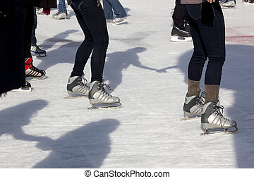 Outdoor Ice Skaters and Shadows - Ice Skaters together...
