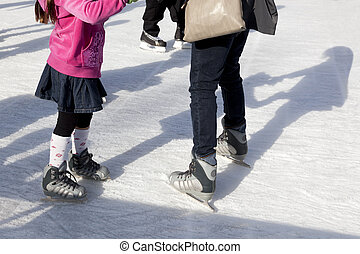Outdoor Ice Skaters and Shadows - Parent and child Ice Skate...