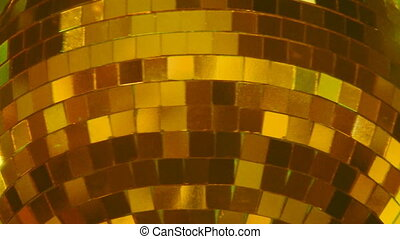 Golden disco ball.  - Big golden disco ball rotates.