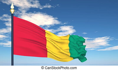 Flag Of Guinea on the background of the sky and flying...