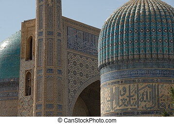 Domes and gateway at Bibi Khanym - Elaborately tiled domes...
