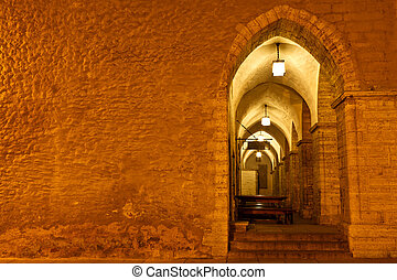 Archway in Tallinn Town Hall at Night in Raekoja Square,...