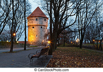 Illuminated Tower in the Old Town of Tallinn , Estonia