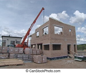 Crane worker construction - New private house construction....
