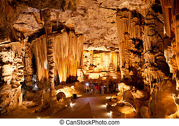 group of tourists visiting Cango Caves in Oudtshoorn,...