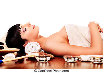 close eyes - Beautiful woman relaxing in a spa salon.