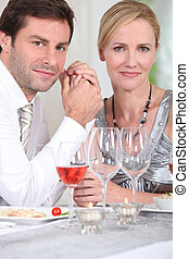 Man and woman enjoying meal
