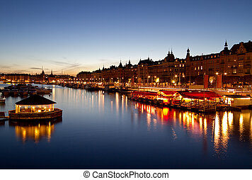 Stockholm waterfront at night.