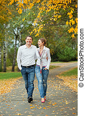Romantic young beautiful couple on autumn walk - Romantic...
