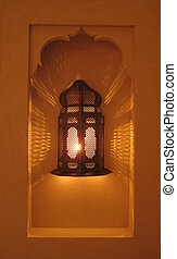 Turkish lantern in stone alcove - Turkish lantern burning in...