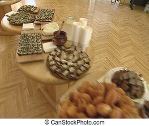 table food buffet - Food on round spread tables for regale...