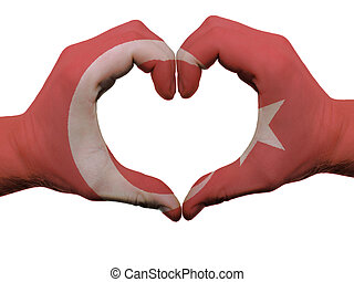 Gesture made by turkey flag colored hands showing symbol of...
