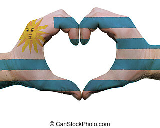 Gesture made by uruguay flag colored hands showing symbol of...