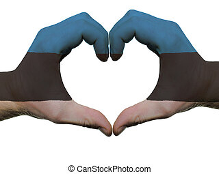 Gesture made by estonia flag colored hands showing symbol of...