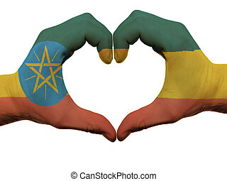 Gesture made by ethiopia flag colored hands showing symbol...