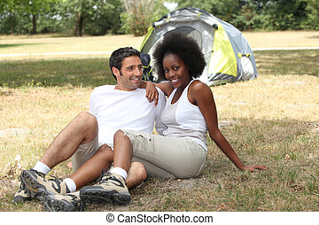 mixed couple camping