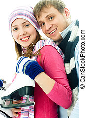 happy young couple going ice-skating - portrait of happy...