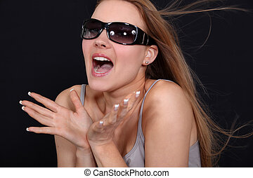 Excited woman wearing sunglasses