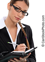businesswoman taking notes