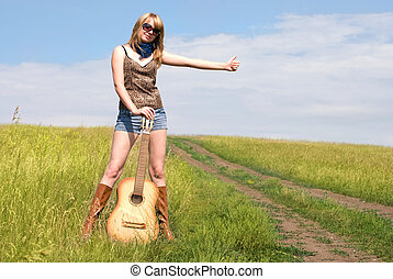 hitchhiker with a guitar