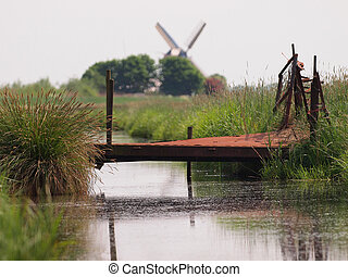 Rusty bridge in rural landscape