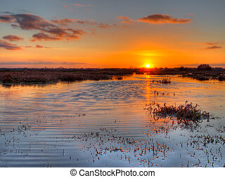 Sunset over dutch wetland in the province of groningen