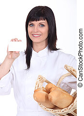 Woman baker showing business card