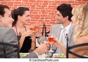 romantic foursome at restaurant