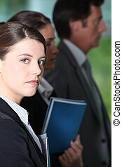 Young woman in a business briefing