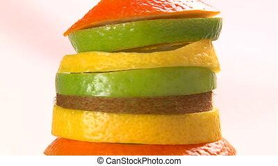 Fruits, peel, rotate. Closeup.