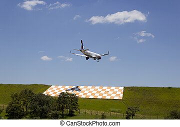 Commercial airplane landing at Viracopos airport.