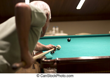 Playing snooker at the club