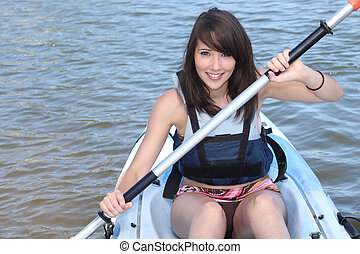 #young brunette in kayak