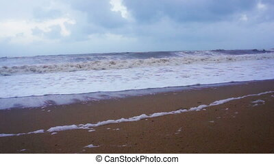 Windy Beach - Monsoon with fast moving clouds along the...