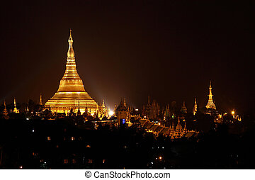 Shwedagon pagoda - view of Shwedagon pagoda at night time in...