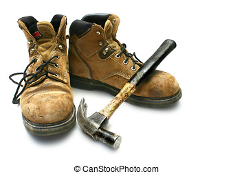 Workboots - Worn, old carpenters work boots with hammer,...