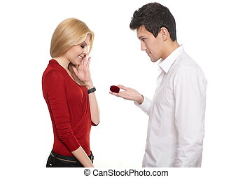 young romantic handsome man presenting jewelry in red...