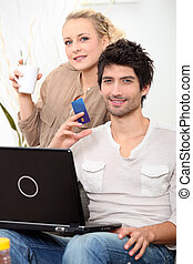 Couple doing online shopping.