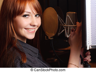 Singing girl - Girl singing to the microphone in a studio