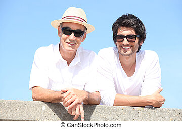 Two men wearing sunglasses in the sunshine