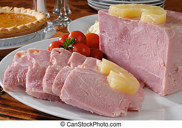 Holiday dinner ham - A sliced ham with pineapple and pumpkin...