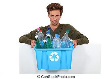Man holding box full of empty bottles
