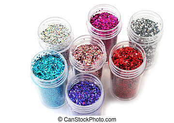 Nail glitters - Colorful nail glitters isolated on white...