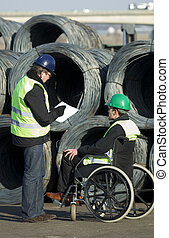 Workers Inspecting At Construction Site - Two workers...